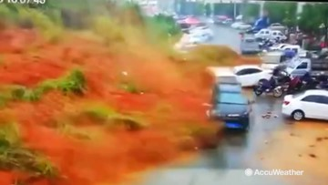 Terrifying moment landslide wipes out parked vehicles