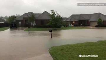 Homes and streets overwhelmed by flooding during severe storm