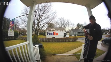 VIDEO: FedEx driver stops to fold downed flag