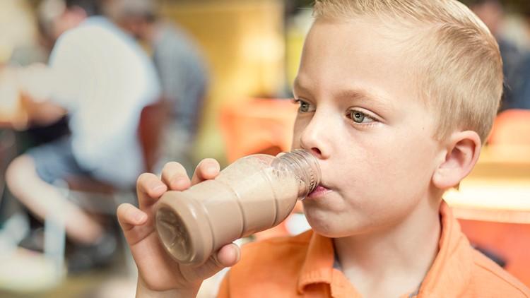 Chocolate milk boy drinking school lunch