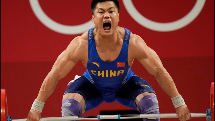 Lyu Xiaojun becomes oldest Olympic weightlifting champ at 37