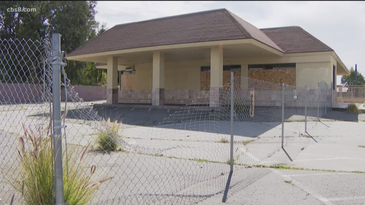Fallbrook's vacant McDonald's building boarded up, volunteers go in to clean