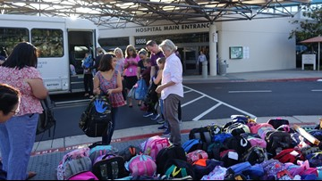Grossmont Hospital nurses donate 160+ backpacks to families affected by HIV/AIDS
