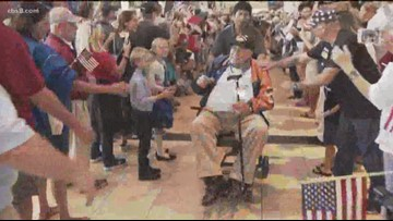 Honor Flight San Diego returns home from tour of war memorials, tributes