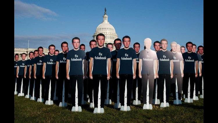 Zuckerberg cutouts outside Congress