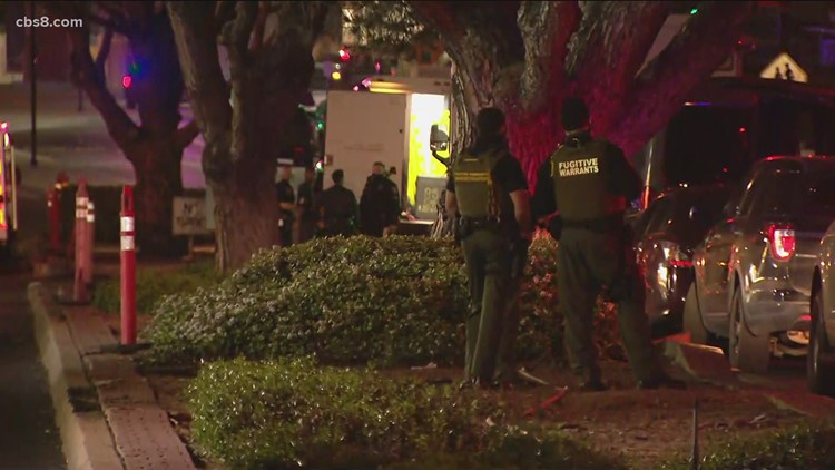 San Diego police search for 2 suspects downtown after shots fired from car during chase
