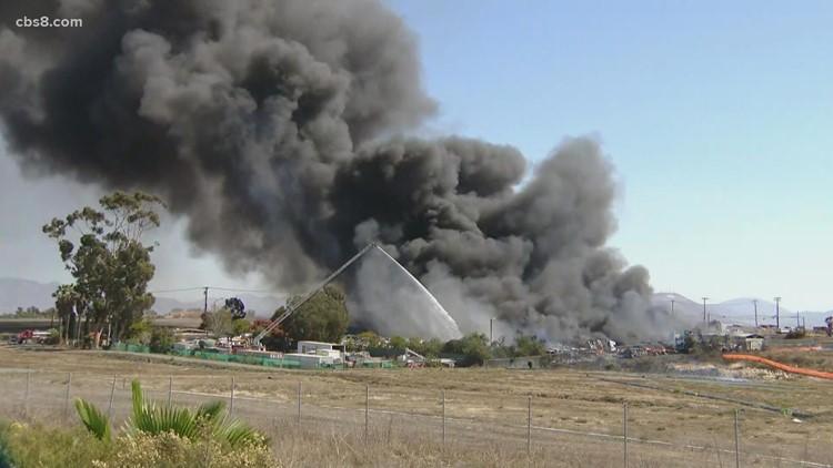Large fire burns at Otay Mesa auto wrecking yard