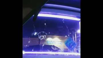 New video of a vandal throwing something through the window of the Southbay Blackwater Tattoo shop