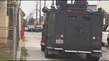 Suspect taken into custody following SWAT standoff in City Heights faces charges including sexual assault