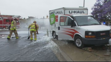 Woman injured after being pinned between U-Haul truck and retaining wall