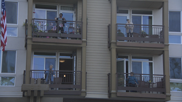 San Diego seniors take exercise class from their balconies