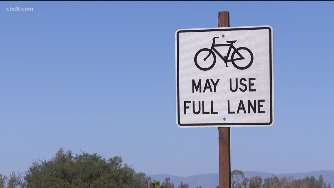 Signs on busy SR-67 say bicyclists 'May use full lane'