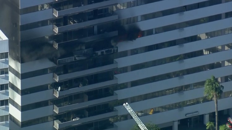 Watch live: High-rise fire erupts at residential building in Los Angeles