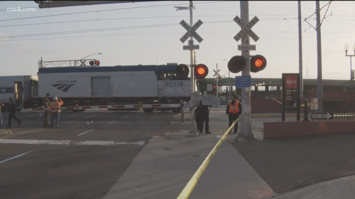 Man killed by train while trying to cross tracks at Washington Street Station
