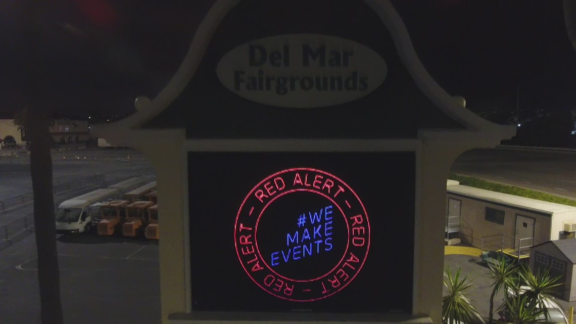 Drone footage of Del Mar fairgrounds Grandstand lit up in red