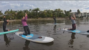 Groovin' with Garegnani: News 8 tries paddle board yoga in Carlsbad