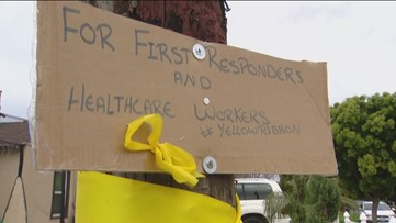 Saying 'thank you' to healthcare workers and first responders with yellow ribbons