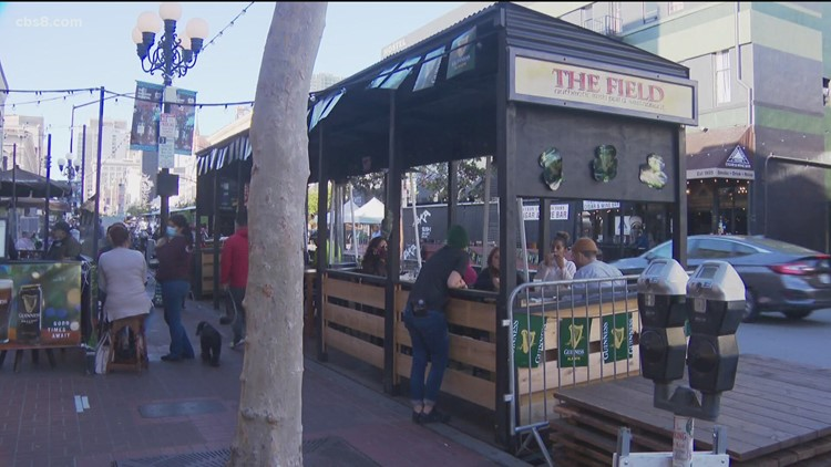 Preparing for St. Patrick's Day in the Gaslamp under the red tier