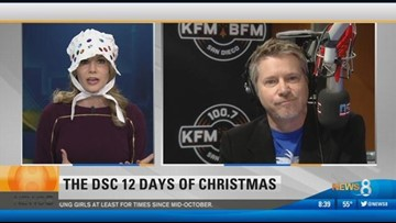 News 8's Heather Myers opens a gift from Dave and the DSC