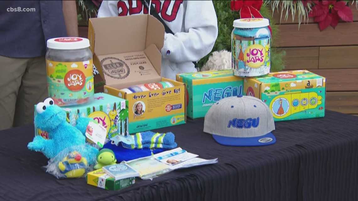 Mike Hess and daughter Keely holding toy drive to bring joy to kids fighting cancer
