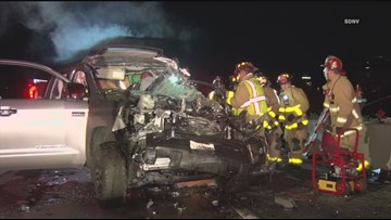 Driver trapped, seriously hurt after crashing into Marine vehicle on I-15