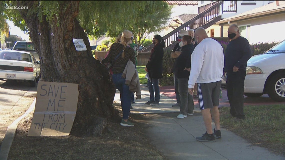 Kensington neighbors stand their ground and continue to protest the removal of 100-year-old pepper trees