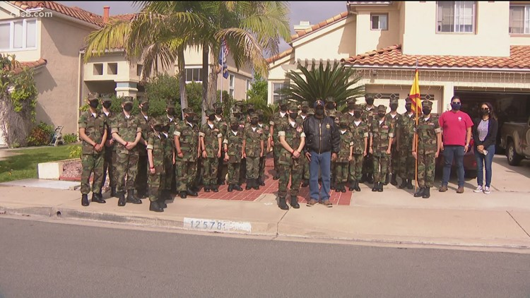 'Young Marines' show appreciation to veterans with flag poles and American flags