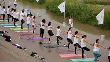 Pose For Peace. Watch as Dozens of Yogis Strike a Pose Along US-Mexico Border
