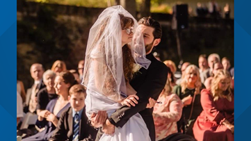 Couple's wedding day goes viral after groom carries sister-in-law down the aisle